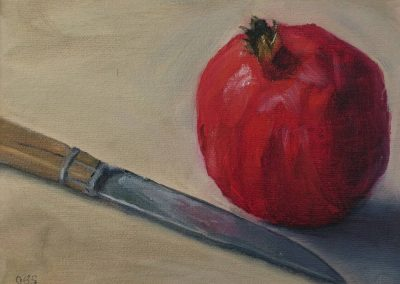 Pomegranate with Knife